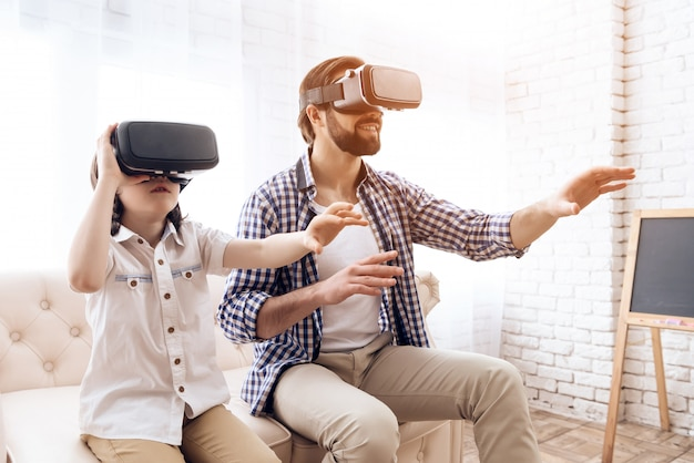 Father and son, using virtual reality glasse.