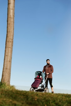 Father and son walking in the park. family and sport concept.