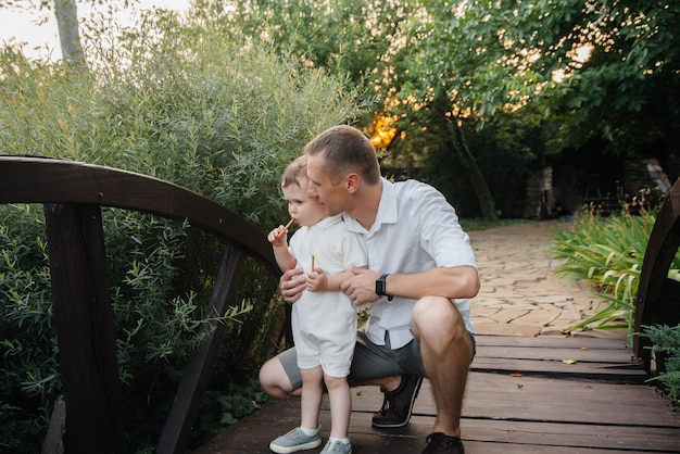 Father and son walking in the park at sunset. happiness. love