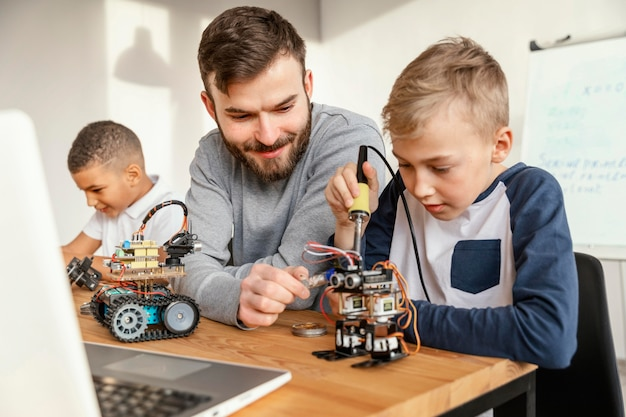Father and sons making robot