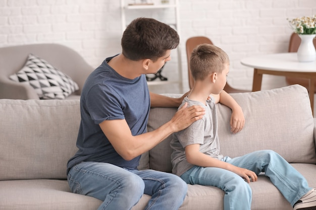 Father trying to make peace with son after quarrel at home