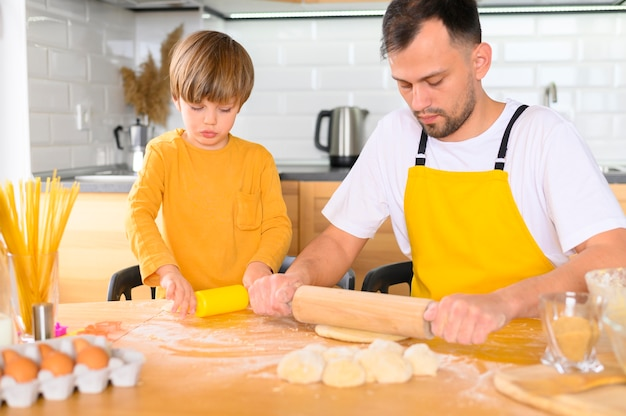 Father using the paddle on the dough