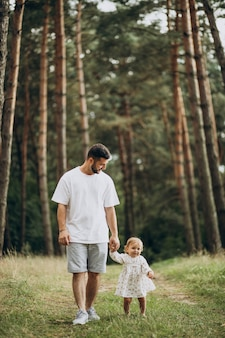 Father walking in park with his baby daughter