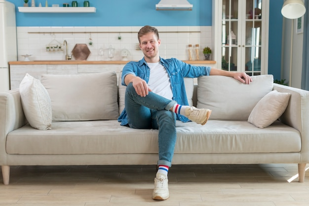 Father wearing casual clothes and sitting on sofa