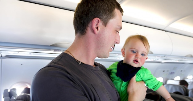 Father with the child on cabin plane.