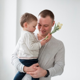 Father with child holding flower