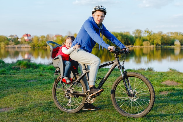Father with daughter on a bicycle