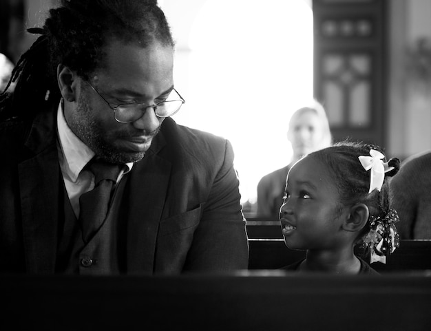 Father with her daughter in a church