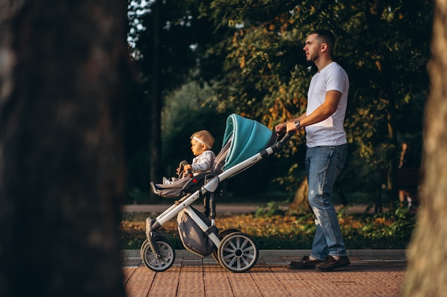Father with his daughter walking in park