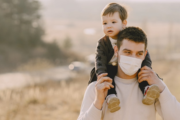 Father with little son wearing masks