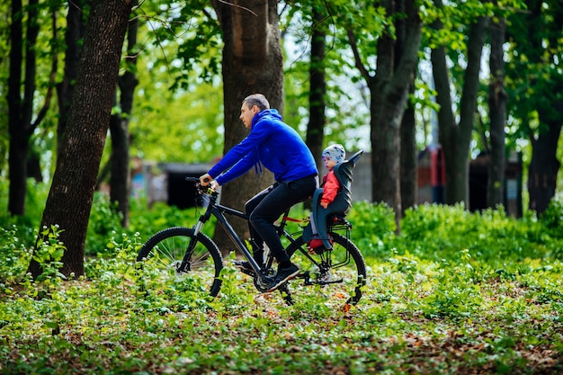 Father with son on a bicycle outside