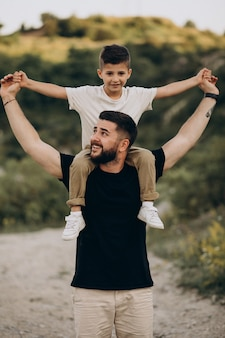 Father with son in forest