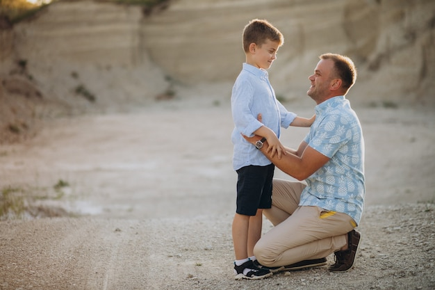 Father with son in sand quarry