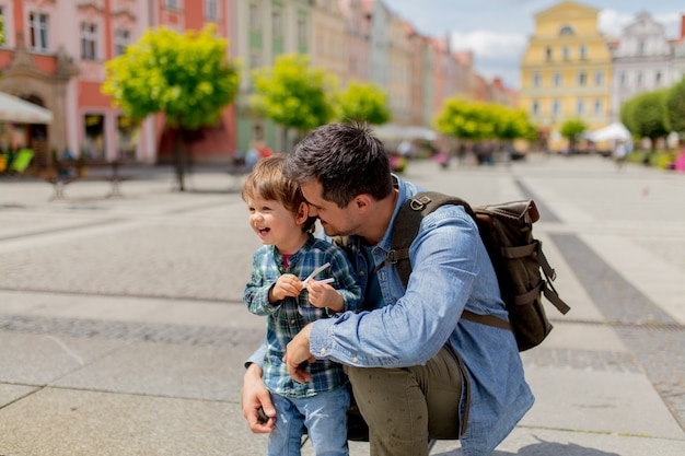 Father with a toddler boy in old city center Premium Photo