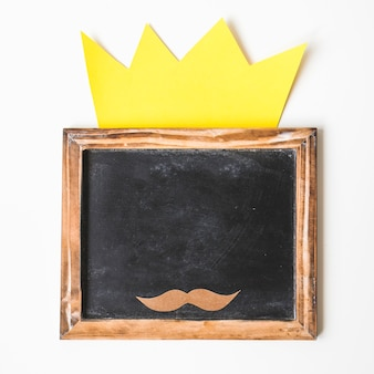 Fathers day composition with crown on slate