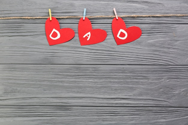 Fathers day composition with hearts on clothesline
