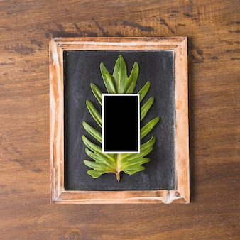 Fathers day composition with instant photo on slate