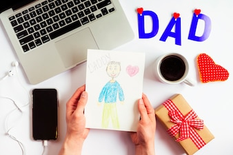 Fathers day composition with laptop and kids drawing