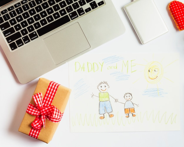 Fathers day composition with laptop and cute drawing