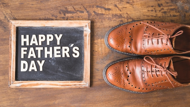 Fathers day composition with slate and shoes