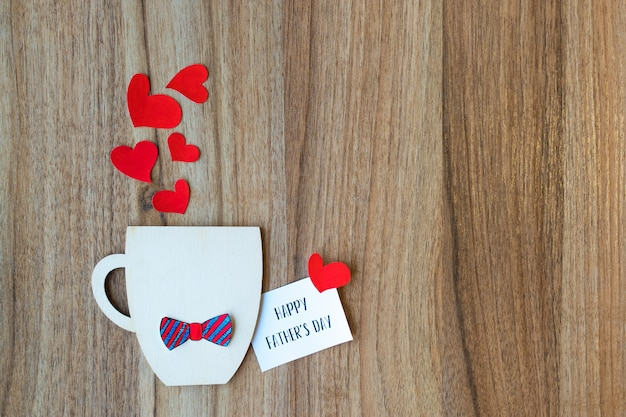Fathers day concept. decorative cup with paper bow-tie and hearts