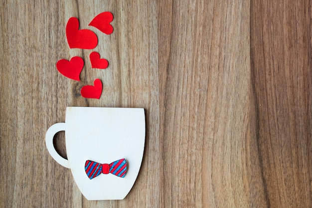 Fathers day concept. decorative cup with paper bow-tie and red hearts