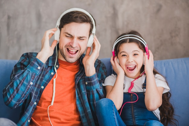 Fathers day concept with father and daughter listening to music