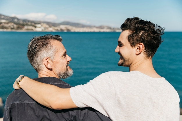 Fathers day concept with father and son in front of sea