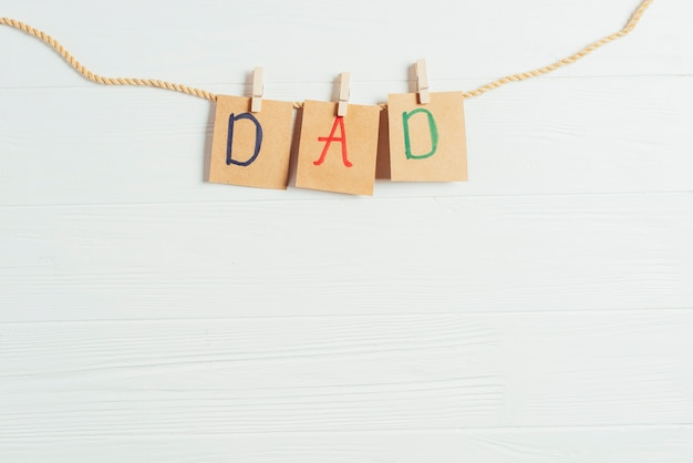 Fathers day concept with letters on clothesline with copyspace