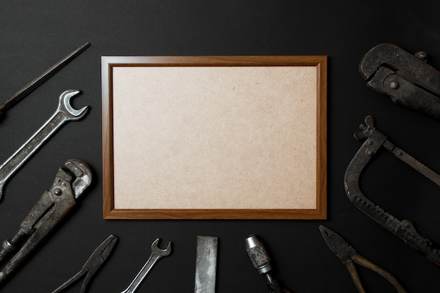 Fathers day greeting card concept. vintage old tools on black paper background. flat lay. copy space.