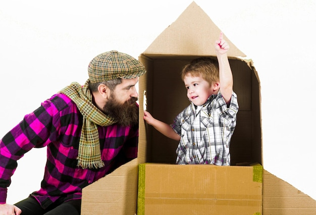 Fathers day parenthood dad and son playing with cardboard rocket childs dream boy play cosmonaut