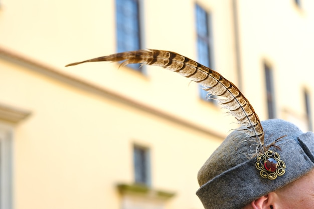 A feather in an old soldier's hat.medieval concept.