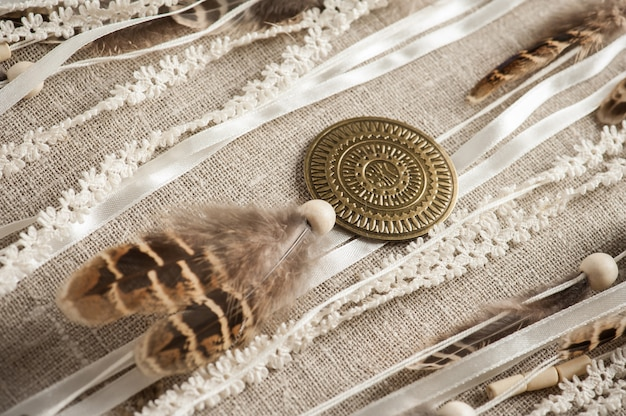 Feathers, pearls, wooden beads