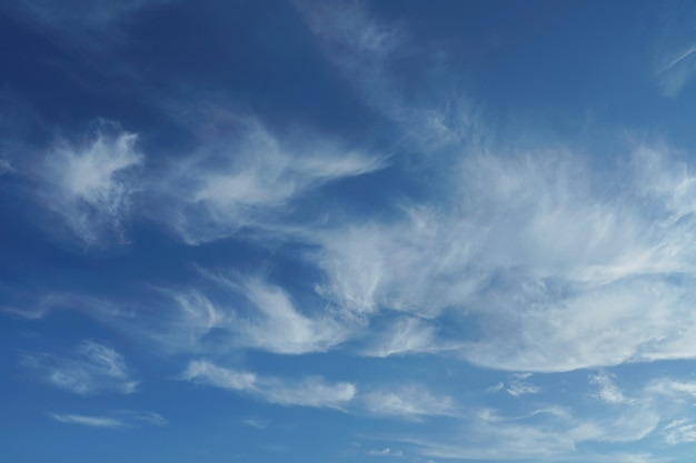 Feathery clouds in the blue sky