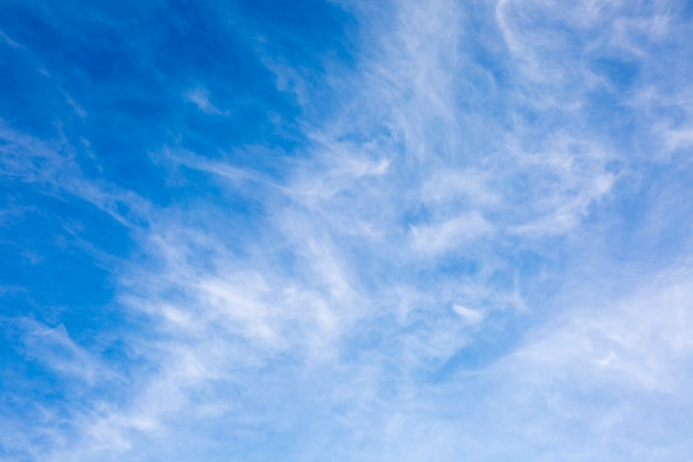 Feathery white clouds in the blue sky,