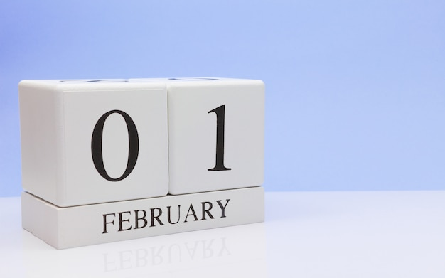 February 01st. day 01 of month, daily calendar on white table.
