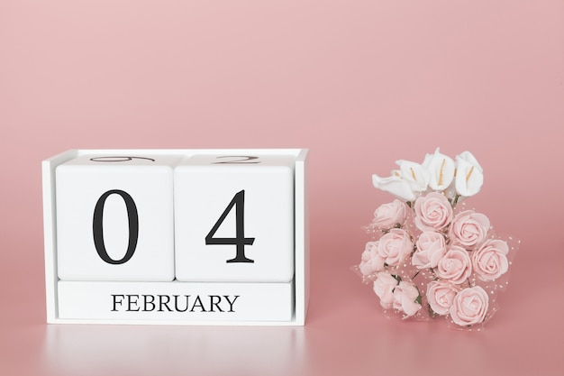 February 04th. day 4 of month. calendar cube on modern pink background, concept of bussines and an importent event.