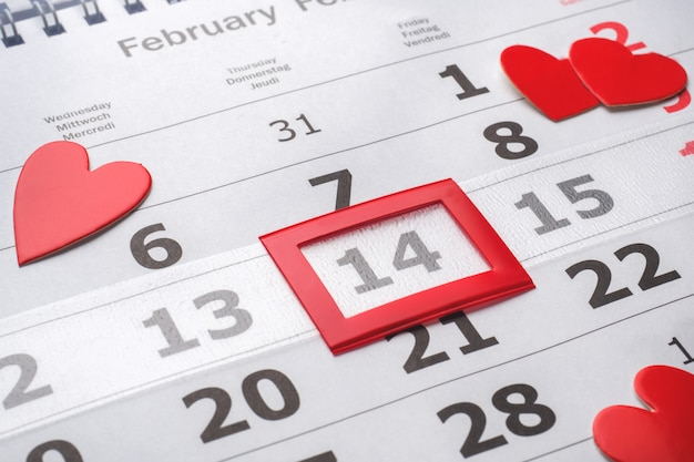 February 14 calendar. valentine's day concept red hearts