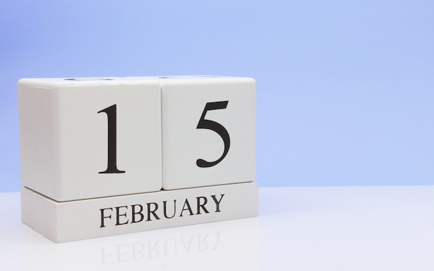 February 15st. day 15 of month, daily calendar on white table.