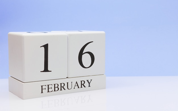 February 16st. day 16 of month, daily calendar on white table.