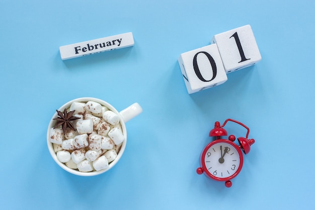 February 1st cup of cocoa with marshmallows and alarm clock