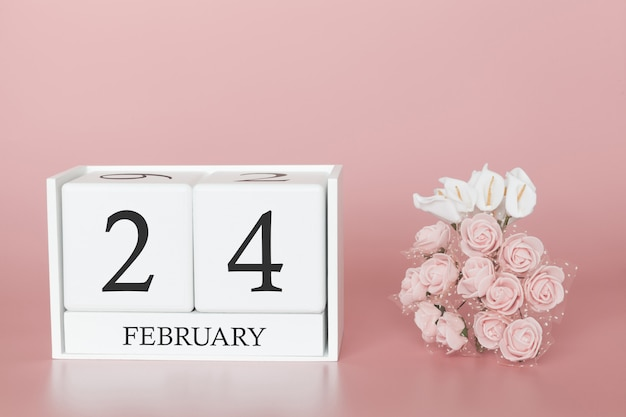 February 24th. day 24 of month. calendar cube on modern pink background, concept of bussines and an importent event.