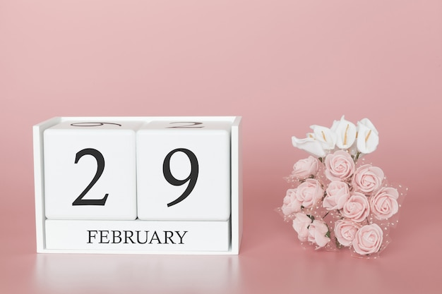 February 29th. day 29 of month. calendar cube on modern pink background, concept of bussines and an importent event.
