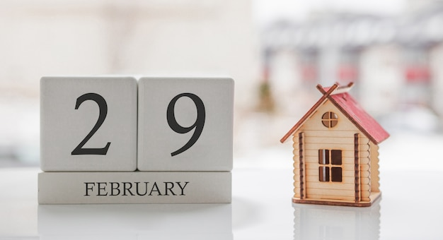 February calendar and toy home. day 29 of month. card message for print or remember