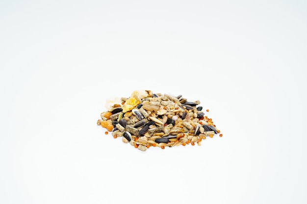 Feed for hamsters granular or as a mixture of seeds on white.