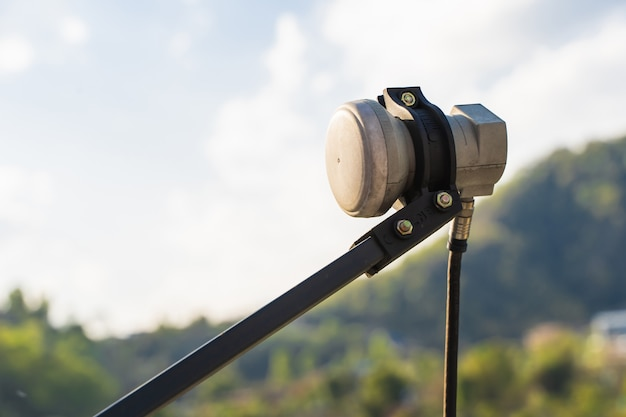 A feed horn receiver of a parabolic satellite dish antenna for tv and internet. close up image, stock photo.