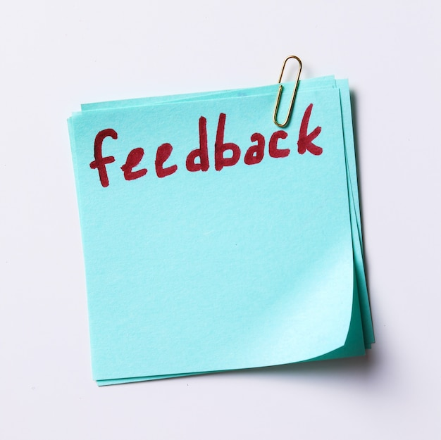 Feedback word written in a paper note