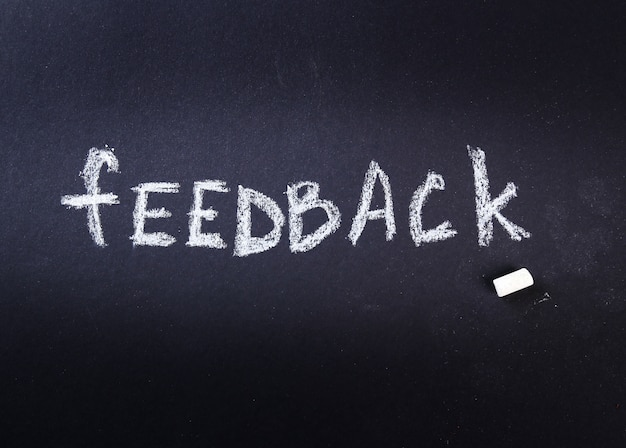 Feedback word written with chalk in a blackboard