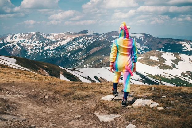 Feel freedom concept in mountains, woman traveling in a unicorn