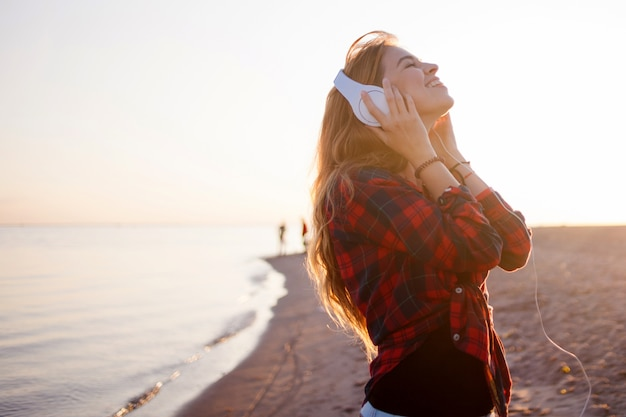 Feel happiness and enjoy life. smiling girl in headphones
